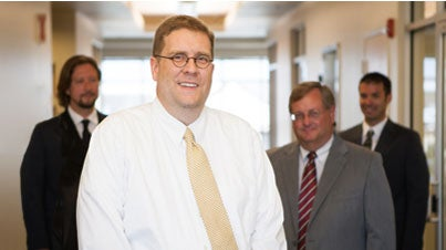 Directing Attorney, John C. Heath with other Lawyers of Lexington Law