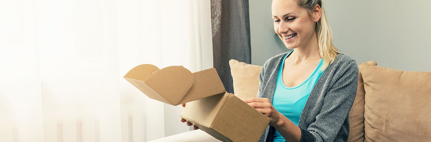 woman opening subscription box