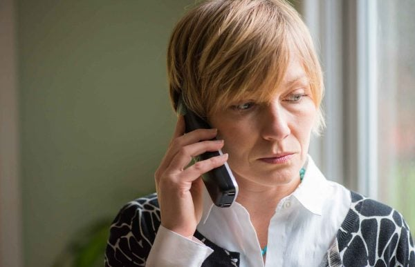 woman on phone speaking with lender