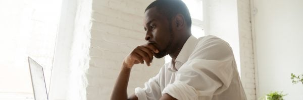 young man contemplating what to do now that credit has been repaired