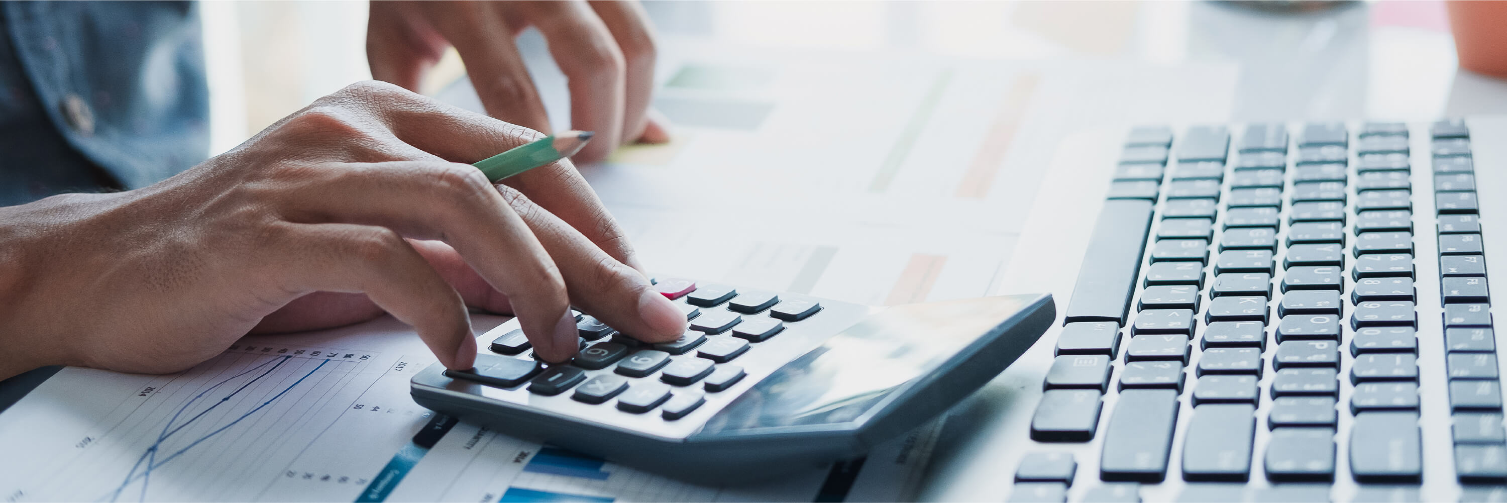 person calculating their taxes with a calculator