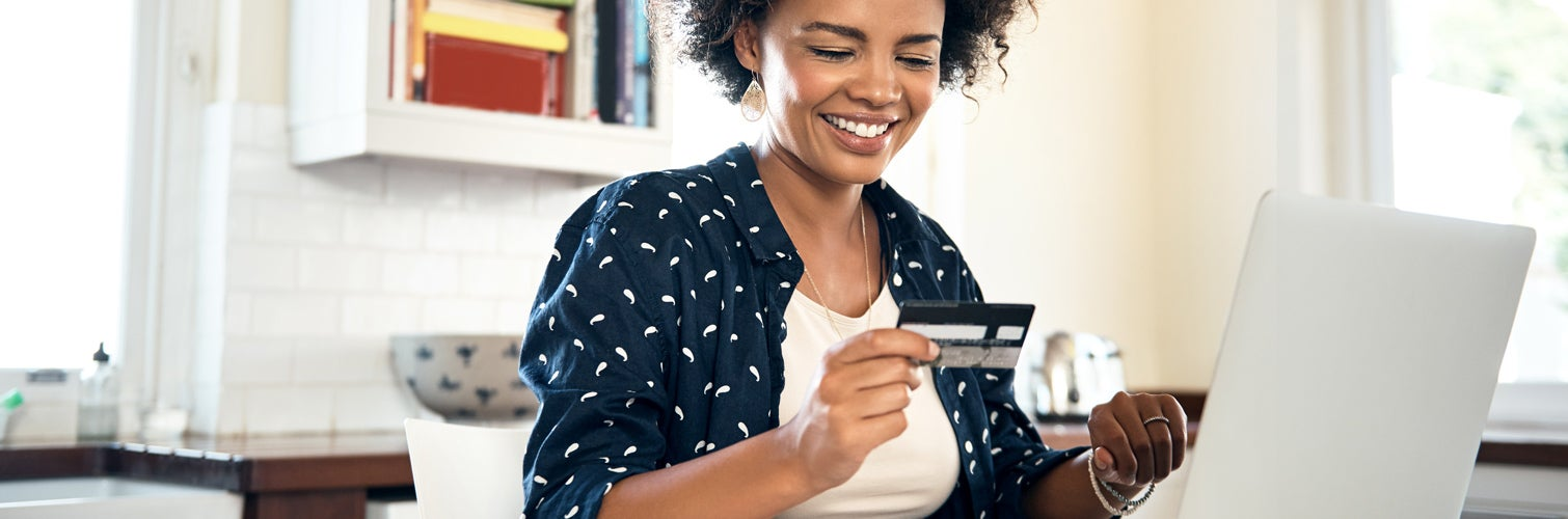 Woman paying off her credit card.